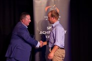 EA Domestic Athlete of the Year Clint Beresford congratulated by EA Board member Mark Hopkinson.