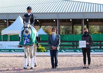 Adrienne Lyle and Harmony's Duval in their awards presentation with Judge at C Cesar Torrente and Caitlin Lane of AGDF. ©SusanStickle.com