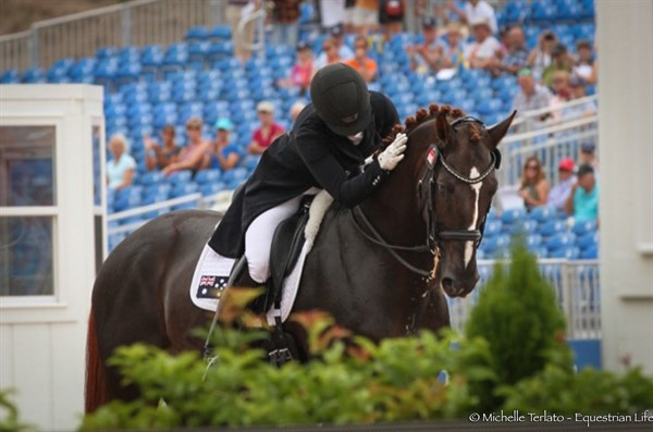 Alexis Hellyer gives Bluefields Floreno a pat after their Grand Prix - © Michelle Terlato