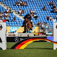 Andrew Hoy and Vassily de Lassos over the last fence.