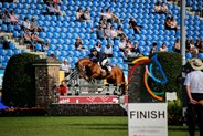 Andrew Hoy and Vassily de Lassos over the penultimate fence.