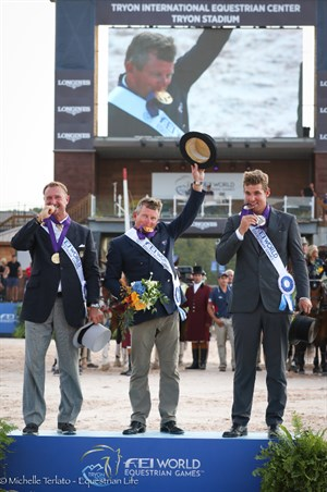 Boyd Exell with his medal (centre), silver medallist Chester Weber (right) and bronze medallist Edouard Simonet (left) - © Michelle Terlato