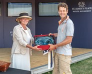 Chris Burton accepts the CIC2* prize for his ride on Bahira M - © William Carey