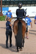 Emma Booth's coach, Lone, has a laugh with her as they enter the arena - © Michelle Terlato