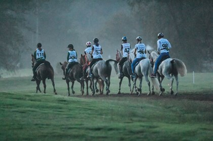 Endurance riders canter after the start at WEG - © FEI/MARTIN DOKOUPIL